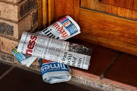 newspapers on front porch